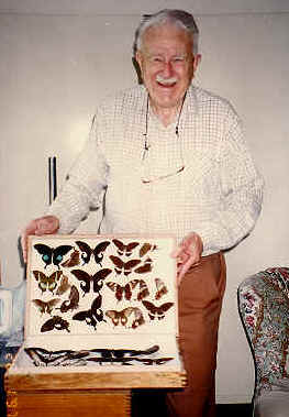 Richard Cranmer (Tim) Dening with one of his cases of butterfly specimens.